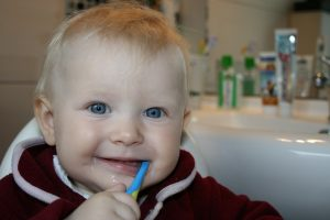 child brushing teeth at home